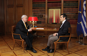 TASS First Deputy Director General Mikhail Gusman and Greek Prime Minister Alexis Tsipras