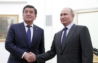 Kyrgyzstani President Sooronbay Jeenbekov and Russian President Vladimir Putin