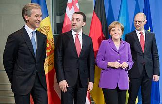 Юрие Лянкэ, Ираклий Гарибашвили, Ангела Меркель и Арсений Яценюк