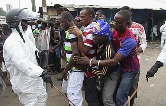 Режим чрезвычайного положения из-за лихорадки Эбола в Либерии, август 2014 года