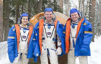 Космонавты Елена Серова и Александр Самокутяев и астронавт НАСА Барри Уилмор (слева направо)