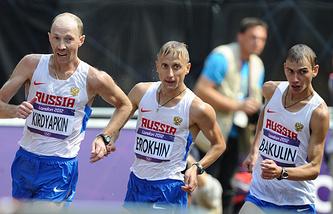 Сергей Кирдяпкин (слева) и Сергей Бакулин (справа) на соревнованиях по спортивной ходьбе на 50 км на ХХХ летних Олимпийских играх в Лондоне. 11 августа 2012 года