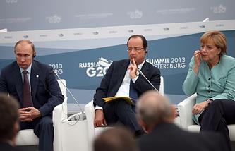 Президент РФ Владимир Путин, президент Франции Франсуа Олланд и канцлер Германии Ангела Меркель (слева направо)