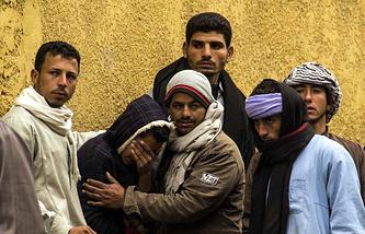 Церемония прощания с коптами, убитыми боевиками ИГ, в египетской Эль-Минье