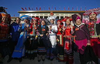 Представители этнических меньшинств Китая