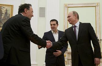Министр окружающей среды и энергетики Греции Панайотис Лафазанис, премьер-министр Греции Алексис Ципрас и президент РФ Владимир Путин