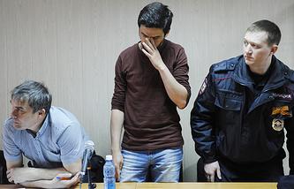 Адвокат Валентин Демиденко и художник Артем Лоскутов (слева направо)