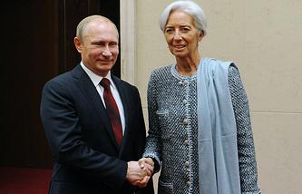 Президент России Владимир Путин и глава Международного валютного фонда Кристин Лагард