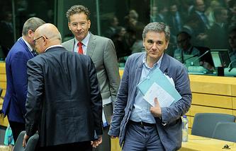 Глава Еврогруппы Йерун Дейсселблум и министр финансов Греции Эвклидис Цокалотос