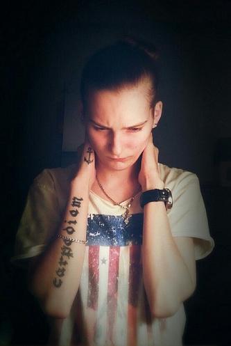 Всего у Марины семь татуировок