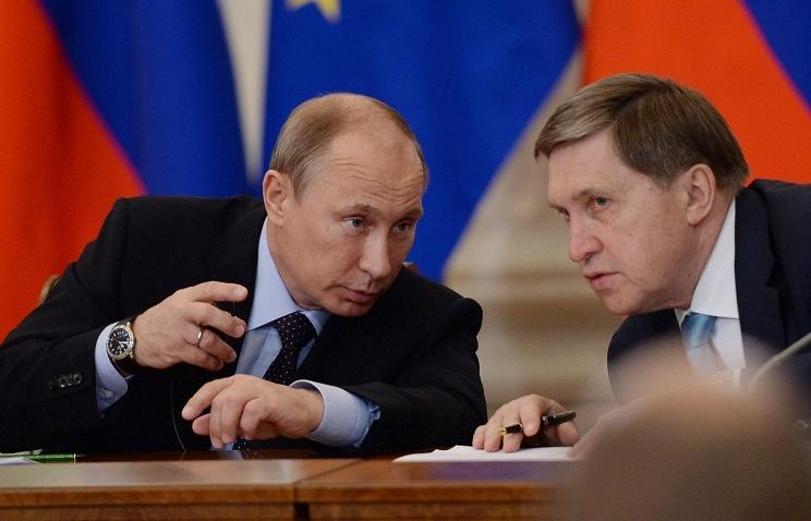 Vladimir Putin and Yuri Ushakov