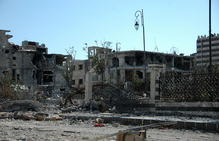 A general view shows damaged buildings at al-Khalidyya neighborhood, Homs, Syria