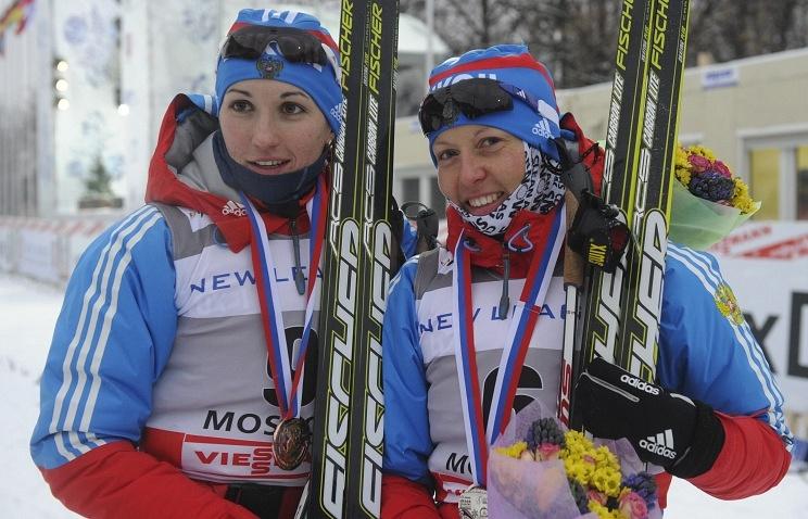 Russian skier Anastasia Dotsenko (left)