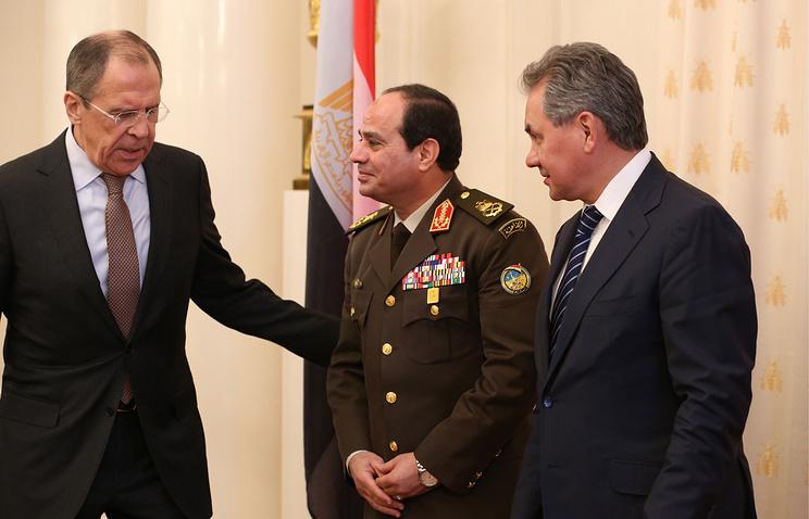 Russia's foreign minister Sergei Lavrov (L), defence minister Sergei Shoigu (R), and Egypt's defence minister Abdel Fattah el-Sisi (C)