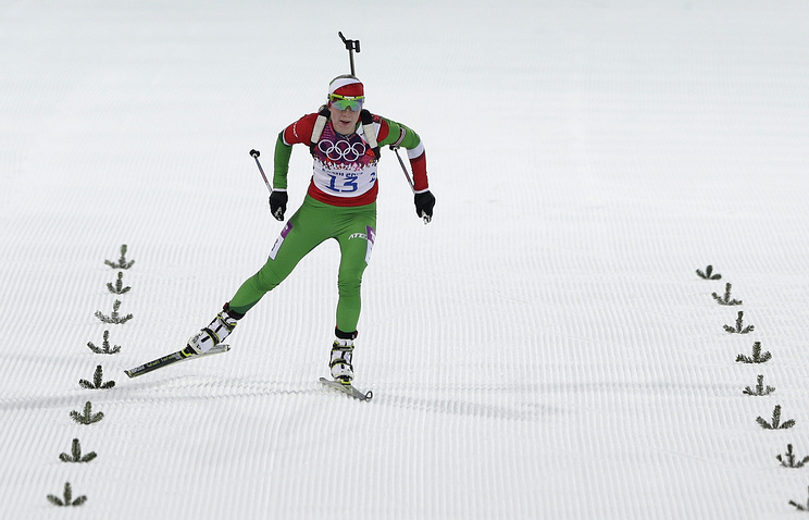 Belarus' Darya Domracheva skis on the finish straight during the women's 15K individual biathlon race