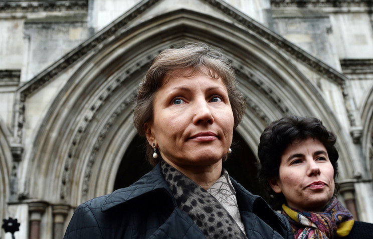 The wife of former KGB spy Alexander Litvinenko, Marina Litvinenko, leaves the High Court in London, Britain