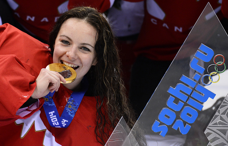 Canada goalkeeper Shannon Szabados poses with her gold medal after winning the Women's Gold Medal match against the US at the Bolshoy Ice Dome in the Ice Hockey tournament