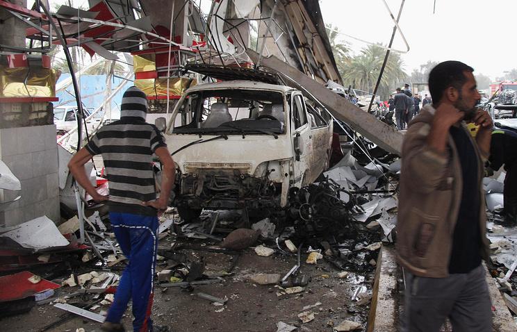 Civilians inspect the site of a massive bomb attack in Hillah March 9