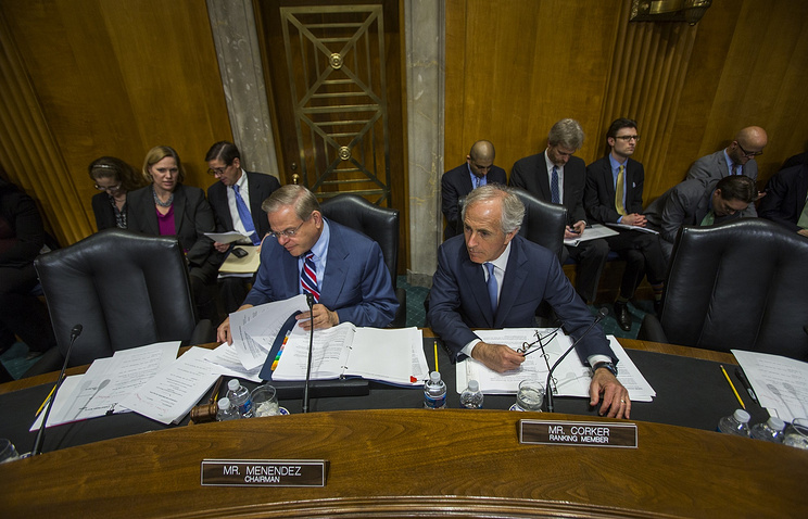 Democratic Senator from New Jersey and Chairman of the Senate Foreign Relations Committee Robert Menendez (L) and Republican Senator from Tennessee Bob Corker (R) prepare to vote to sanction Russia