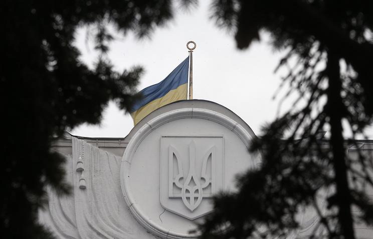 Ukrainian national flag on top of the Verkhovna Rada building