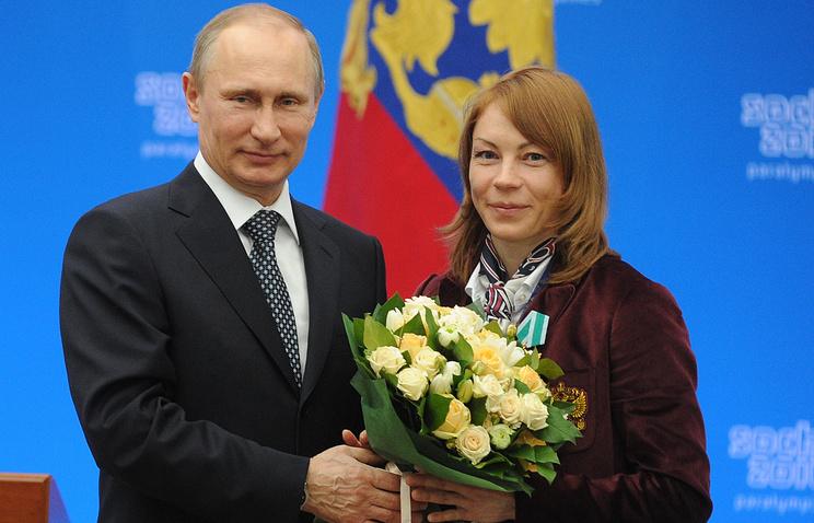 Vladimir Putin and Paralympic champion Inga Medvedeva