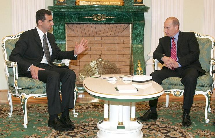 Russia's President Putin (R) and Syrian President Bashar al-Assad (L)