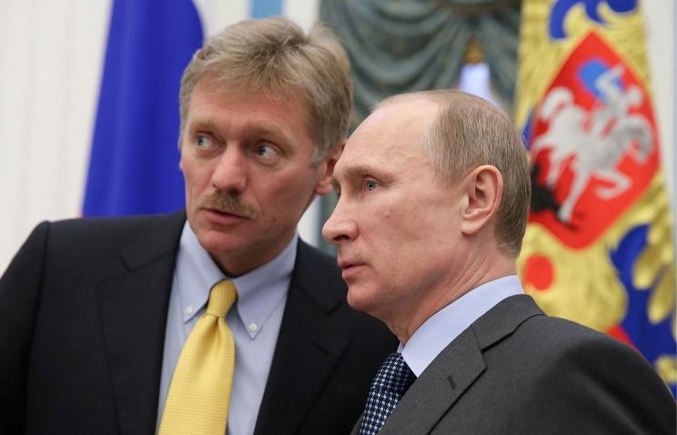 Russian President Vladimir Putin(R), President's press secretary(L)