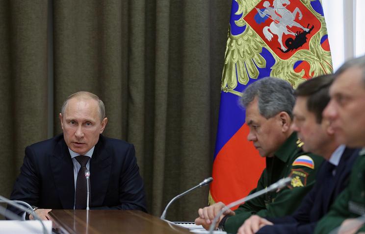 Vladimir Putin (left) during a meeting on May 14