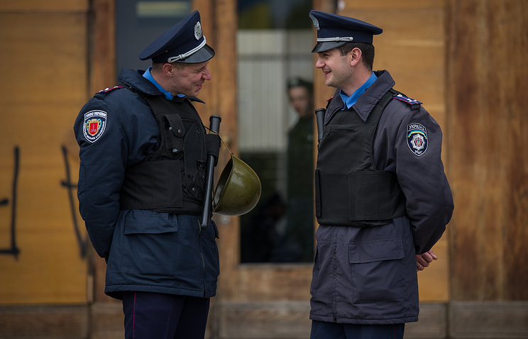 Ukrainian policemen guard in and outside the regional government building in the southern Ukrainian city of Odessa