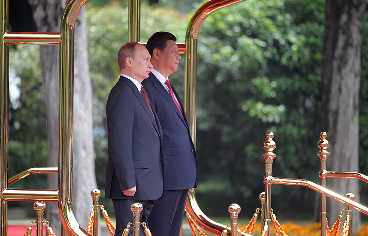Vladimir Putin and Xi Jinping