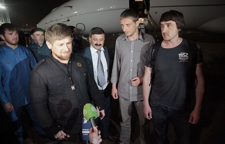 Chechen leader Ramzan Kadyrov (left) accompanied by Russian journalists Oleg Sidyakin  (second right) and Marat Saichenko (right)