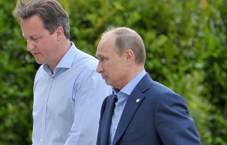 Russia's President Vladimir Putin (right) and Britain's  Prime Minister David Cameron