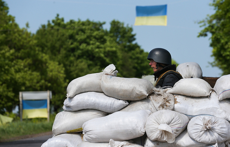 A Ukrainian army soldier at a checkpoint in east Ukraine