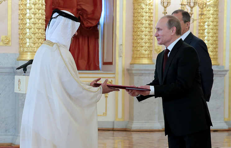 Russia's president Vladimir Putin (right) receives the credentials from Qatar's Ambassador to Russia Saud Ben Abdullah Zaid al-Mahmoud