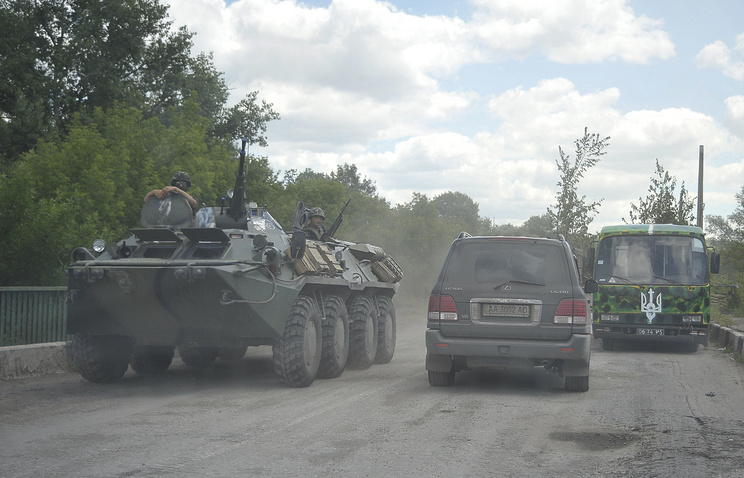 Ukrainian soldiers transported on an armoured personnel carrier outside Luhansk