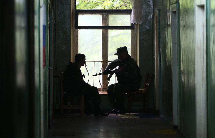 Militia fighters in Ukraine's Luhansk Region