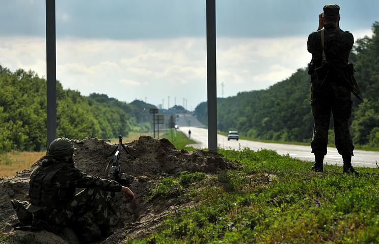 Border guards during observation near Russian checkpoint Novoshakhtinsk