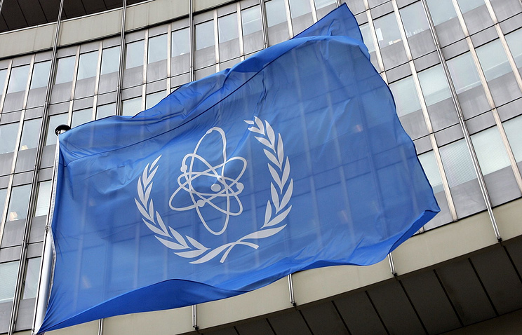 Flag of the IAEA waving in front of the organisation's headquarters