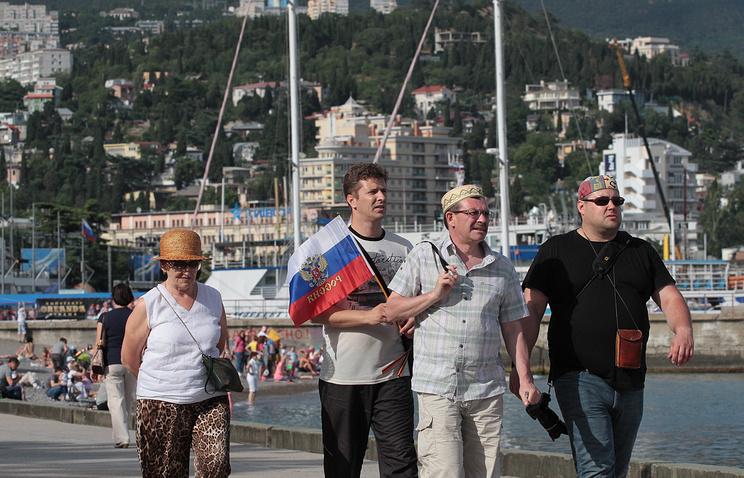 People walk along Yalta's embankment, Crimea