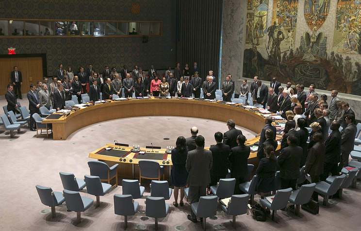 A moment of silence is held in commemoration for victims of flight MH17 at the United Nations Security Council meeting