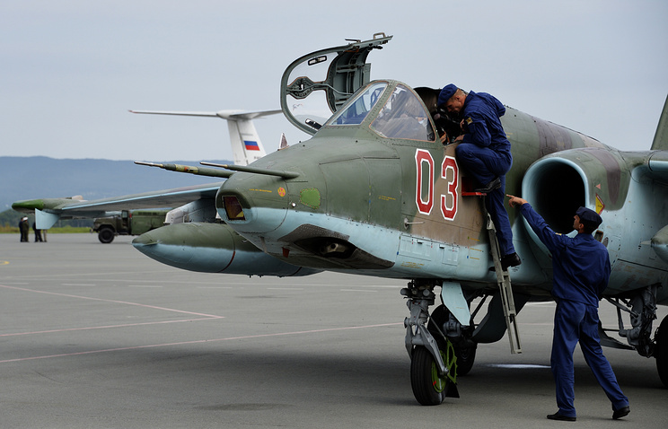 Russian military servicemen get ready to head for China to take part in Peace Mission 2014 drills, Aug. 2014