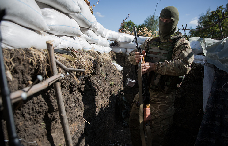 A Ukrainian soldier seen in a trench in Luhansk Region