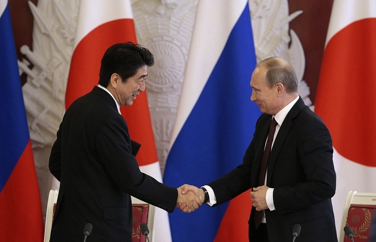 Japan's Prime Minister Shinzo Abe and Russian President Vladimir Putin