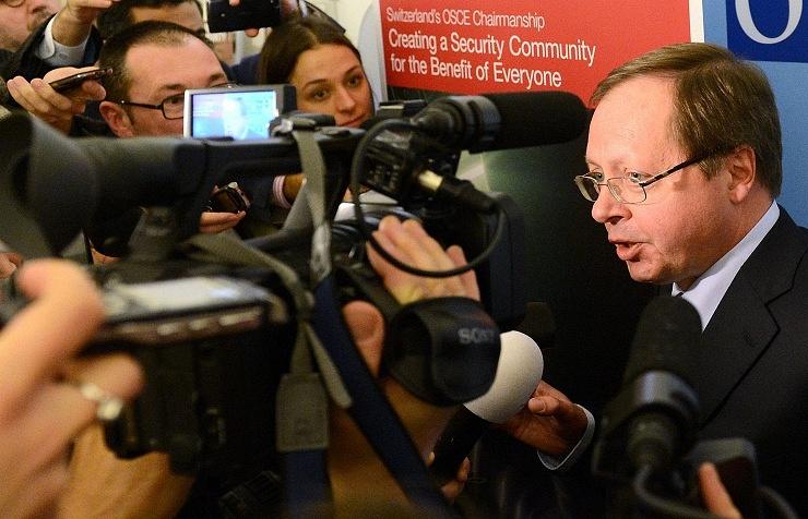 Andrei Kelin talks to reporters