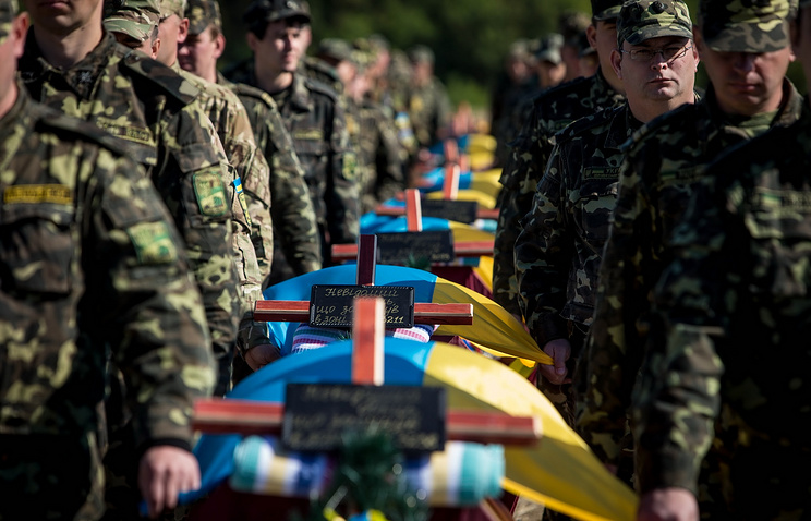People carry coffins with bodies are of soldiers allegedly killed during the battle of Ilovaisk
