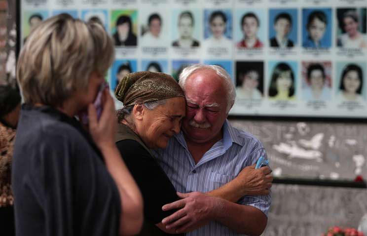 People mourn the victims of the 2004 Beslan school siege