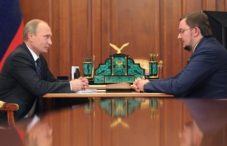 Vladimir Putin (L) and Alexey Repik (R)