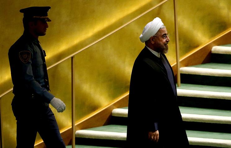 Iranian President Hassan Rouhani (right)
