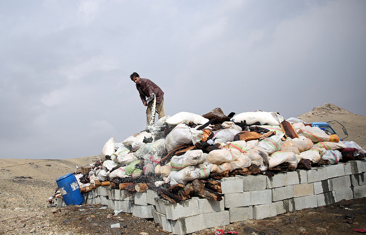 Drug burning preparations on the outskirts of Kabul, Afghanistan