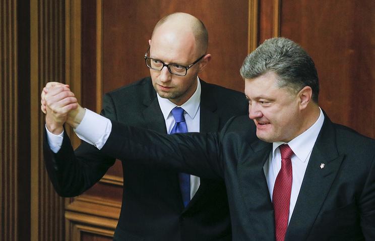 Ukrainian President Petro Poroshenko congratulates the newly elected Ukrainian Prime Minister Arseniy Yatsenyuk